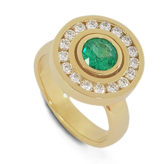 Emerald diamond surround halo engagement ring